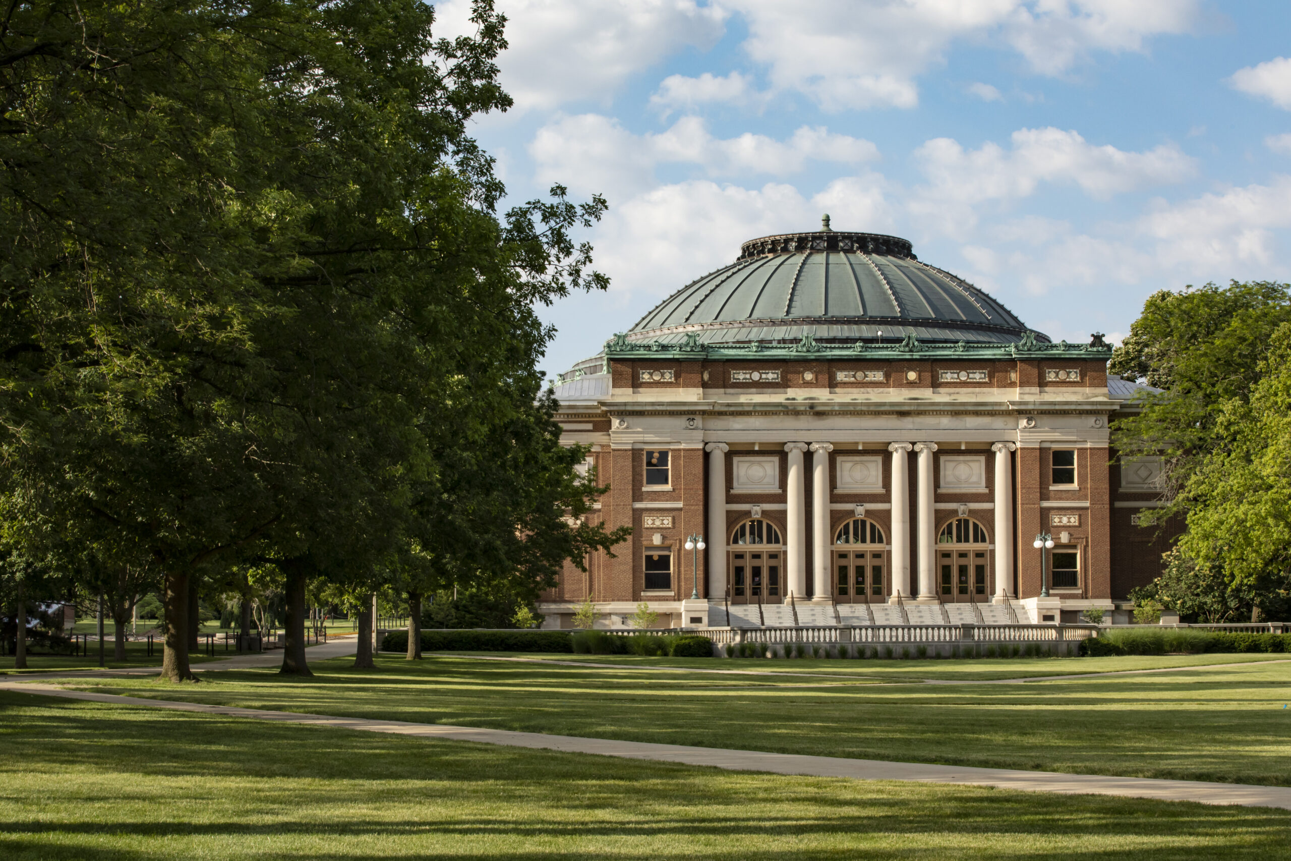 foellinger auditorium surrounded by green grass and trees