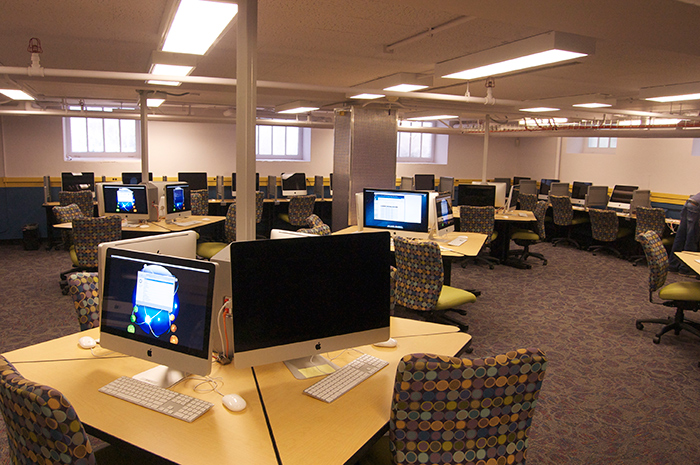 computer lab with desks, computers and chairs